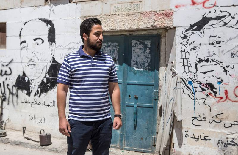 Anas Abu Srour,30, at the entrance of the Aida refugee camp . He was born and raised in the camp and feels that it is his obligation to stay .Photo by Heidi Levine for The National