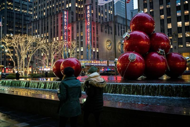 People walk around Christmas decorations  as the global outbreak of the coronavirus disease (COVID-19) continues, in New York City, U.S., December 9, 2020. REUTERS/Eduardo Munoz