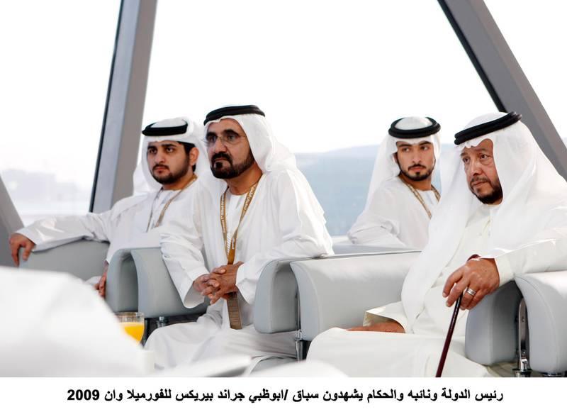 YAS ISLAND, ABU DHABI, UNITED ARAB EMIRATES - November 1, 2009: (left) Sheikh Maktoum bin Mohammed bin Rashid Al Maktoum, Deputy Ruler of Dubai, (2nd left)  HH Sheikh Mohammed bin Rashid Al Maktoum, Vice-President, Prime Minister of the UAE and Ruler of Dubai, (2nd right) Sheikh Mayed bin Mohammed bin Rashid Al Maktoum,   (right) Sheikh Sultan bin Zayed Al Nahyan, prepare to watch the Formula One race at Shams tower in Abu Dhabi. ( Ryan Carter / The National )  *** Local Caption ***  wam64 1-11-09.jpg wam64 1-11-09.jpg