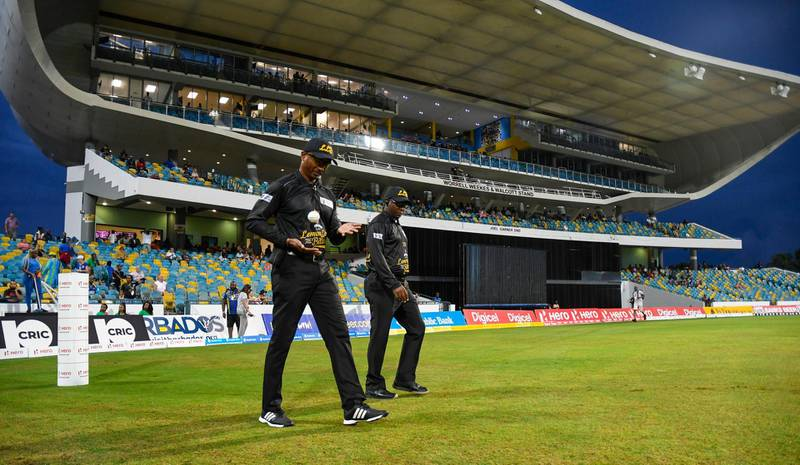 BRIDGETOWN, BARBADOS - SEPTEMBER 23: In this handout image provided by CPL T20, Umpires Gregory Brathwaite (L) and Nigel Duguid (R) walk onto the field before the start of match 20 of the Hero Caribbean Premier League between Barbados Tridents and Jamaica Tallawahs at Kensington Oval on September 23, 2019 in Bridgetown, Barbados. (Photo by Randy Brooks - CPL T20/CPL T20 via Getty Images)
