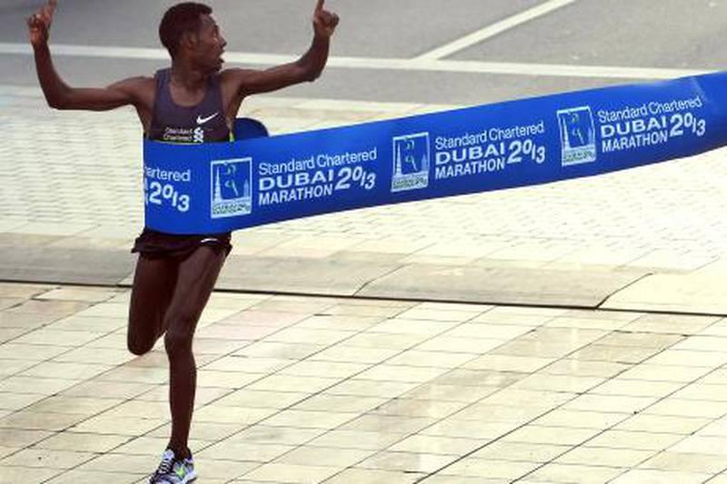 Lelisa Desisa Benti of Ethiopia crosses the finish line to win the Standard Chartered Dubai Marathon in Dubai, United Arab Emirates, Friday Jan. 25, 2013. (AP Photo)
