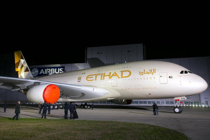 The first Etihad Airways PJSC Airbus A380-800 aircraft is rolled out during an event to mark its unveiling at the Airbus Group NV paint plant in Hamburg, Germany, on Thursday, Sept. 25, 2014. Etihad unveiled a new livery design that will be introduced across its fleet as it officially rolled out its first Airbus A380 aircraft in Hamburg yesterday. Photographer Krisztian Bocsi/Bloomberg