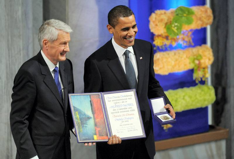 US President Barack Obama (R) holds his Nobel Peace Prize next to Chairman of the Norwegian Nobel Committee, Thorbjoern Jagland, during the Nobel Peace Prize Ceremony at the Oslo City Hall in Oslo on December 10, 2009. Nobel Peace Prize laureate, US President Barack Obama faces a tricky task of reconciling the revered honor with his decision just last week to send 30,000 troops to escalate the war in Afghanistan, a move which tripled the US force there since he took office.     AFP PHOTO/Jewel SAMAD / AFP PHOTO / JEWEL SAMAD