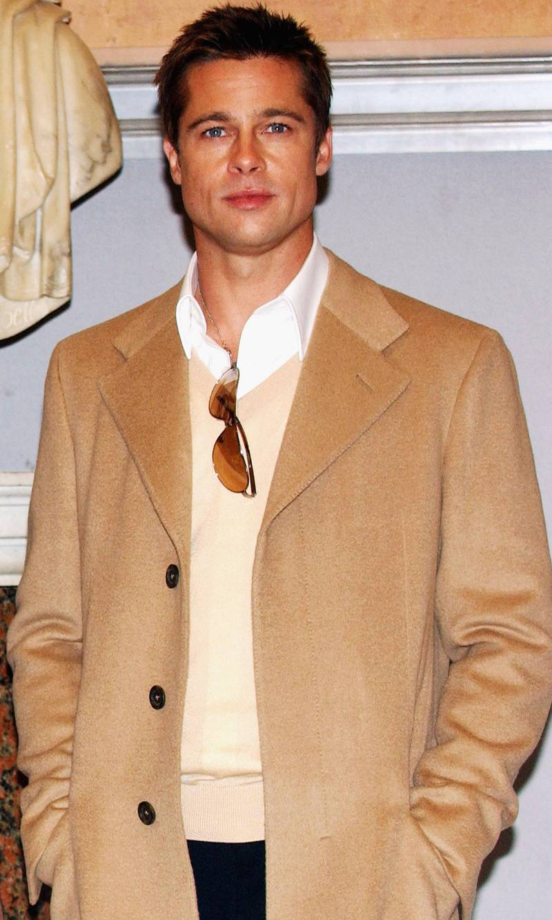 """ROME, ITALY - DECEMBER 10:  Actor Brad Pitt poses at a photocall to promote his new film """"Ocean's Twelve"""" - the sequel to """"Ocean's Eleven"""" - at the Sala della piccola Protomoteca, Campidoglio on December 10, 2004 in Rome, Italy.  (Photo by Franco Origlia/Getty Images)"""