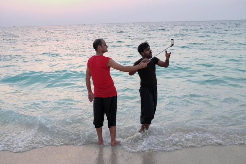 DUBAI, UNITED ARAB EMIRATES. 21 AUGUST 2018. Residents of Dubai enjoy the Eid break by visiting the sunset beach next to the Burj Al Arab. (Photo: Antonie Robertson/The National) Journalist: None. Section: National.
