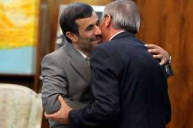 Iranian President Mahmoud Ahmadinejad (L) greets Lebanese Foreign Minister Ali al-Shami prior to a meeting in Tehran on August 8, 2010, as the latter begins an official visit to Iran. AFP PHOTO/STR *** Local Caption ***  155614-01-08.jpg