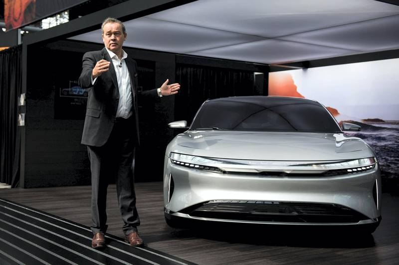 Peter Rawlinson, chief technology officer for Lucid Motors Inc., speaks next to the company's Air alpha prototype vehicle during the 2017 New York International Auto Show (NYIAS) in New York, U.S., on Thursday, April 13, 2017. The New York International Auto Show, North America's first and largest-attended auto show dating back to 1900, showcases an incredible collection of cutting-edge design and extraordinary innovation. Photographer: Mark Kauzlarich/Bloomberg