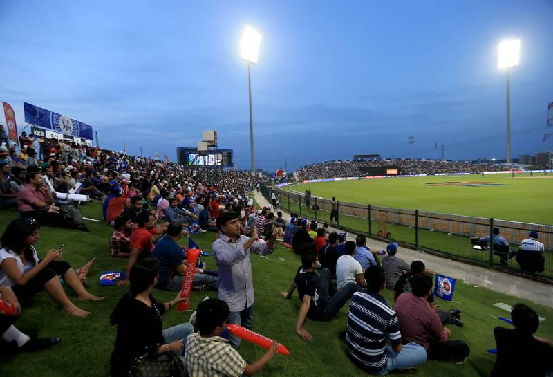 ABU DHABI - UNITED ARAB EMIRATES - 16APR2014 - IPL fans watch the opening match between Mumbai Indians and Kolkata Knight Riders in IPL 2014 yesterday at Zayed Cricket Stadium in Abu Dhabi. Ravindranath K / The National
