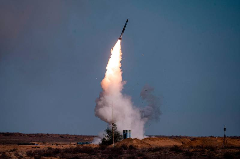 """(FILES) In this file photo taken on September 22, 2020 A rocket launches from a S-400 missile system at the Ashuluk military base in Southern Russia during the """"Caucasus-2020"""" military drills gathering China, Iran, Pakistan and Myanmar troops, along with ex-Soviet Armenia, Azerbaijan and Belarus. The United States on December 14, 2020 imposed sanctions on Turkey's military procurement agency after the NATO ally defiantly bought Russia's S-400 air defense system. / AFP / Dimitar DILKOFF"""