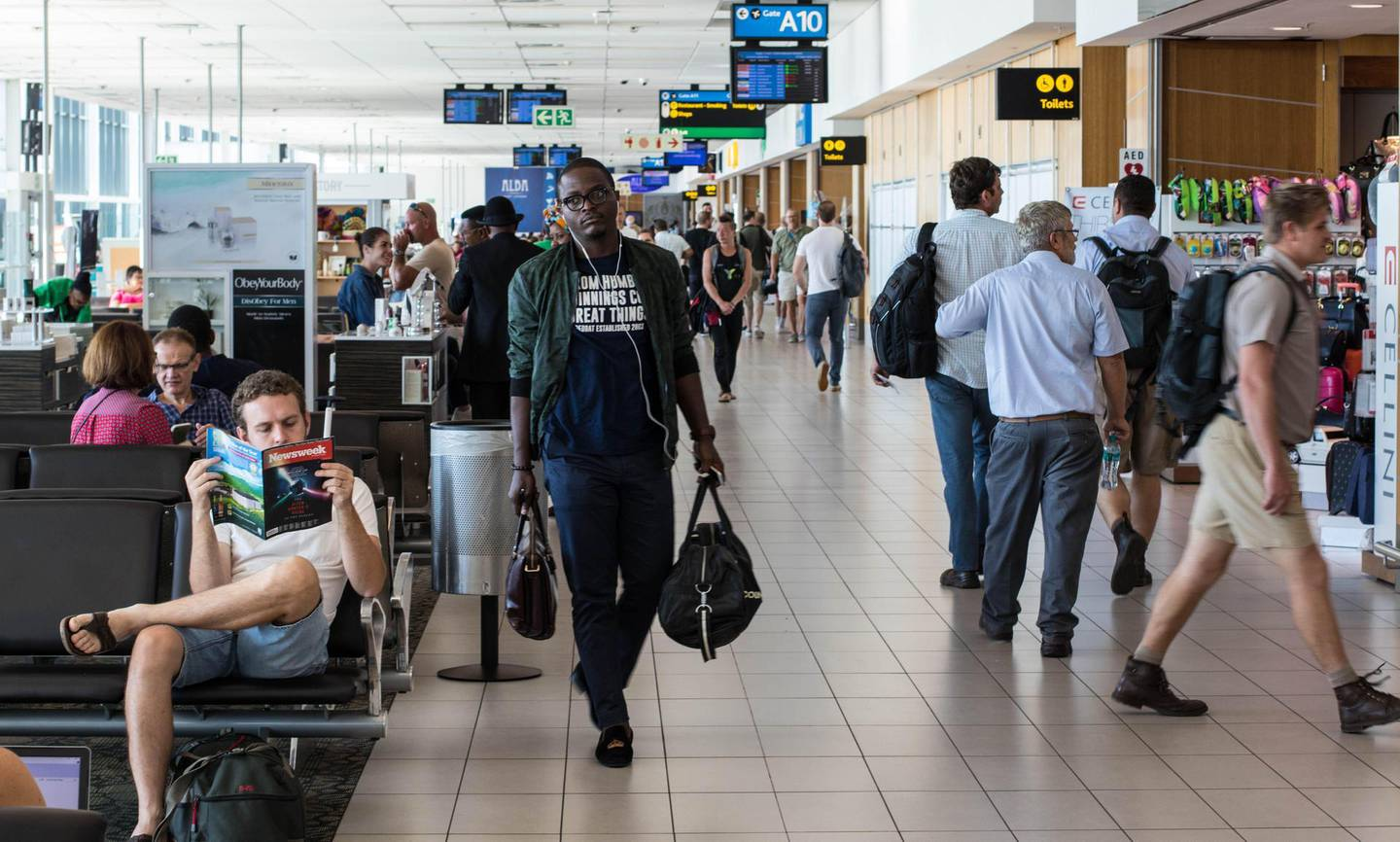 M73C6F Cape Town, South Africa - unidentified passengers await their flights at the local departures terminal at Cape Town International Airport in the city. Alamy Stock Photo