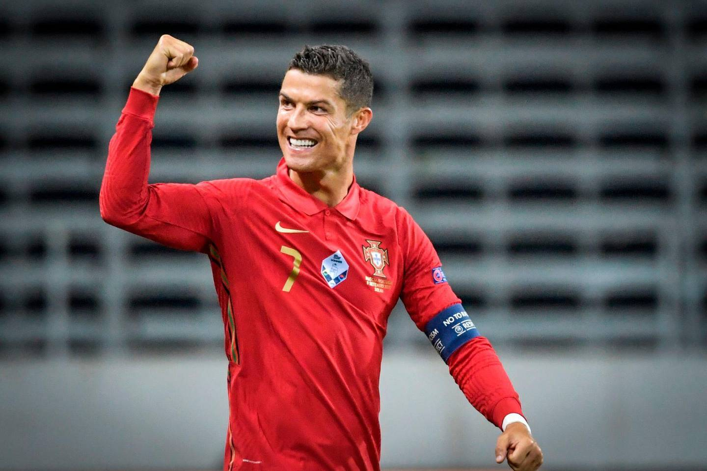 TOPSHOT - Portugal's forward Cristiano Ronaldo celebrates scoring the opening goal, his 100th goal for Portugal, during the UEFA Nations League football match between Sweden and Portugal on September 8, 2020 in Solna, Sweden.  - Sweden OUT  / AFP / TT NEWS AGENCY / Janerik HENRIKSSON