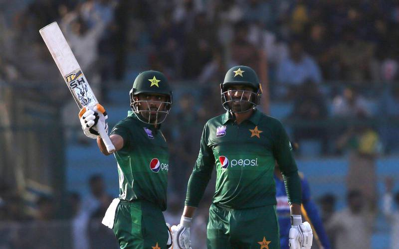 Babar Azam, left, acknowledges his fifty against Sri Lanka with Haris Sohail, in Karachi, Pakistan, Monday, Sept. 30, 2019. Pakistan play a second one-day international after winning the toss and elected to bat against Sri Lanka. (AP Photo/Fareed Khan)