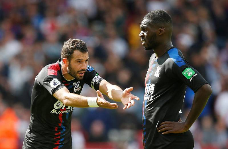 """Soccer Football - Premier League - Sheffield United v Crystal Palace - Bramall Lane, Sheffield, Britain - August 18, 2019  Crystal Palace's Luka Milivojevic gestures as Christian Benteke looks on  REUTERS/Andrew Yates  EDITORIAL USE ONLY. No use with unauthorized audio, video, data, fixture lists, club/league logos or """"live"""" services. Online in-match use limited to 75 images, no video emulation. No use in betting, games or single club/league/player publications.  Please contact your account representative for further details."""