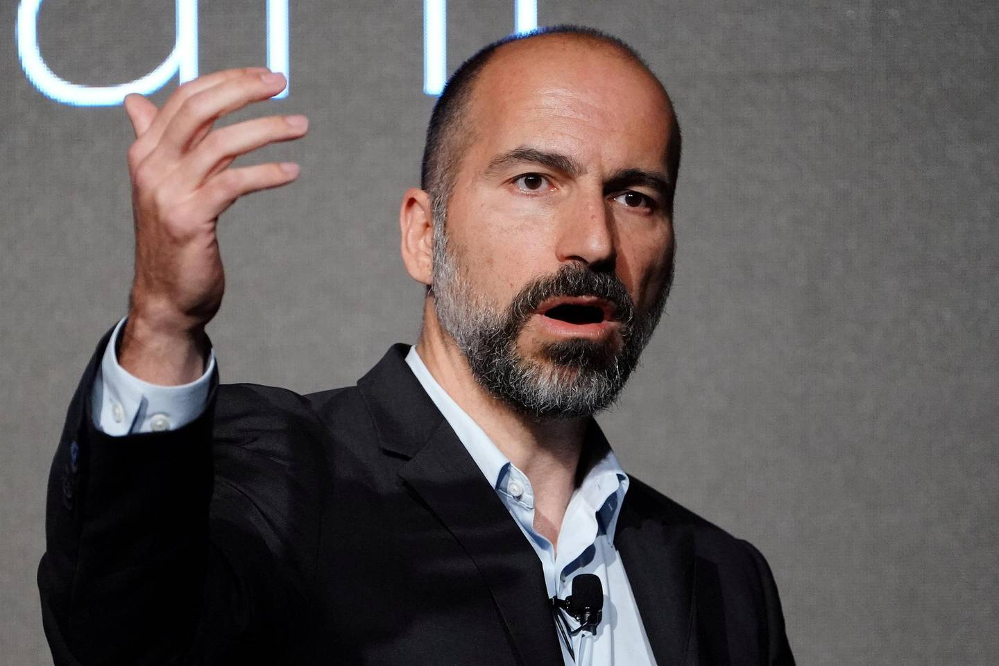 FILE PHOTO: Uber Chief Executive Dara Khosrowshahi pictured on stage during an event in New York City, New York, U.S., September 5, 2018. REUTERS/Carlo Allegri/File Photo