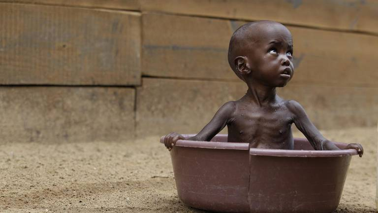 An image that illustrates this article Newborns will face 'seven times more heatwaves than their grandparents'