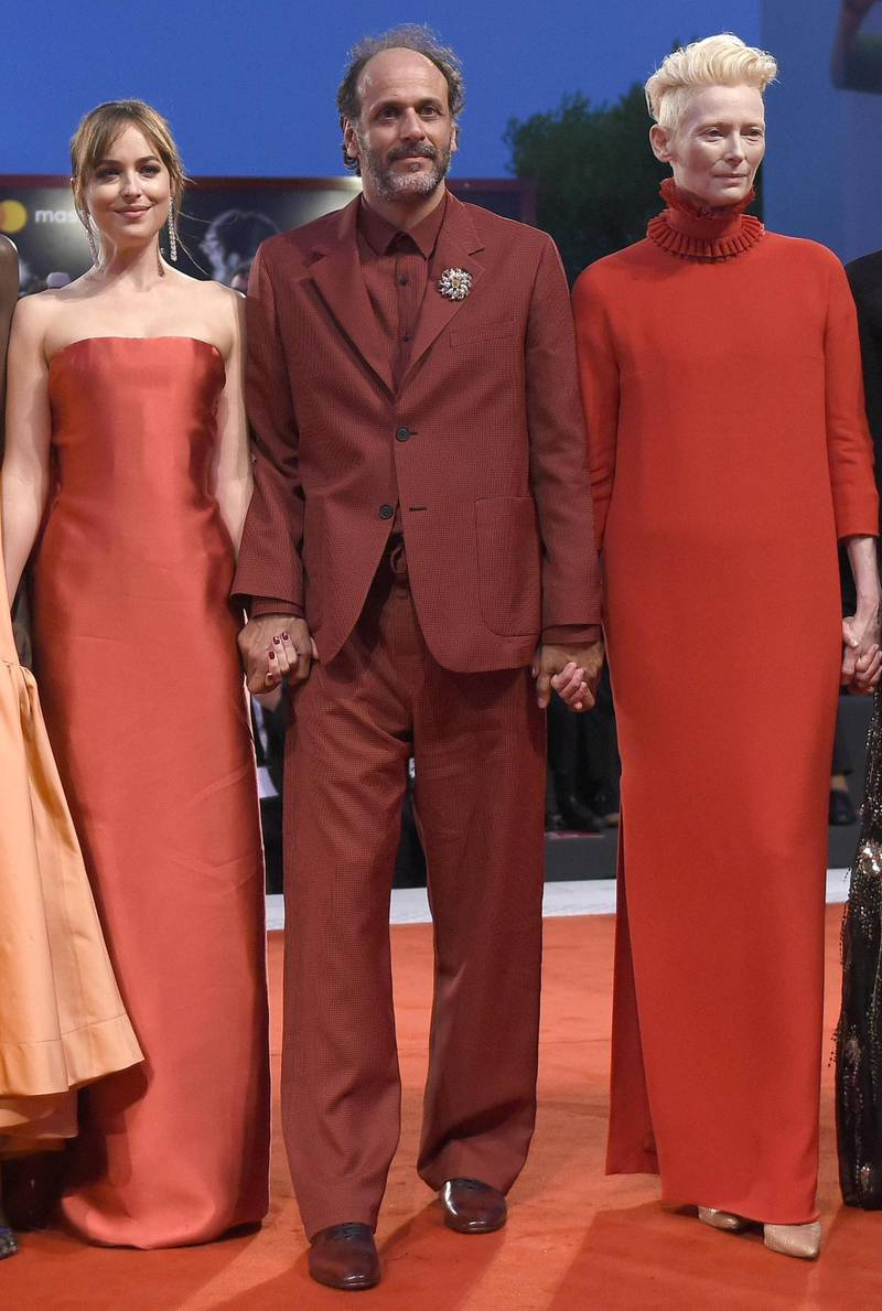 epa06991065 (L-R) US actress Dakota Johnson, Italian film director Luca Guadagnino and British actress Tilda Swinton arrive for the premiere of 'Suspiria' during the 75th annual Venice International Film Festival, in Venice, Italy, 01 September 2018. The movie is presented in the official competition 'Venezia 75' at the festival running from 29 August to 08 September 2018.  EPA/CLAUDIO ONORATI