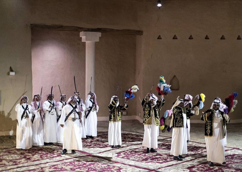 RIYADH, KINGDOM OF SAUDI ARABIA. 26 SEPTEMBER 2019. Saudi traditional dance performance inside At-Turaif district in Ad-Dariya.At-Turaif was founded in the 15th century, with much influence owed to the Najdi architectural style of Arabia. In the mid-18th century, the sprawling mud-brick city spawned the dynasty of Al Saud, who had lived in Ad Diriyah since the 15th century. The largest single structure in the city is Salwa Palace, which extends over approximately 10,000 square metres and consists of seven main units. The palace contains the Ad Diriyah museum, with more museums set to come.Former villa residences that once housed families in 18th-and 19th-century At-Turaif have been converted into a souq, plus an array of cubbyhole areas where demonstrations of traditional crafts now take place – calligraphy, medicine, carpet weaving and the making of weapons are among the attractions. Again, all the staff are Saudis.(Photo: Reem Mohammed/The National)Reporter:Section: