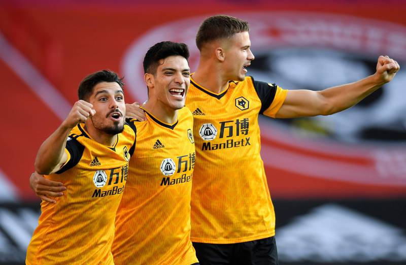 """Wolverhampton Wanderers' Raul Jimenez (centre) celebrates with team-mates Pedro Neto (left) and Leander Dendoncker after scoring his side's first goal of the game during the Premier League match at Bramall Lane, Sheffield. PA Photo. Picture date: Monday September 14, 2020. See PA story SOCCER Sheff Utd. Photo credit should read: Peter Powell/NMC Pool/PA Wire. EDITORIAL USE ONLY No use with unauthorised audio, video, data, fixture lists, club/league logos or """"live"""" services. Online in-match use limited to 120 images, no video emulation. No use in betting, games or single club/league/player publications."""