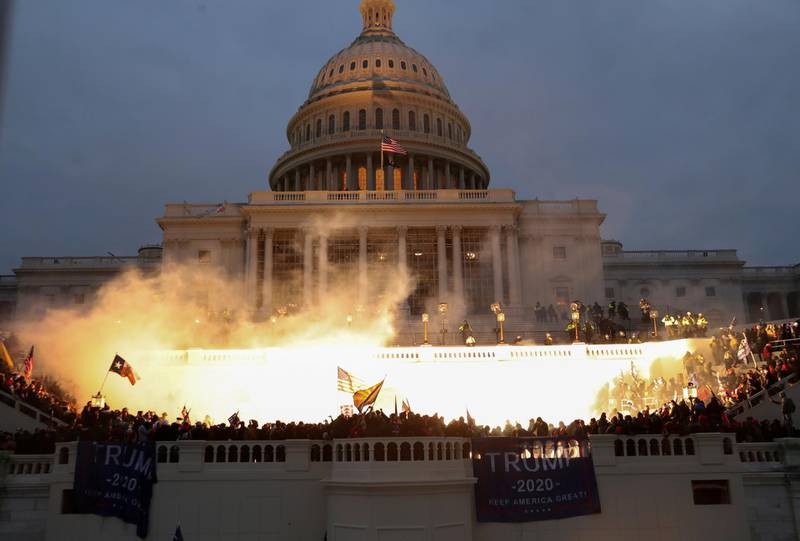 An explosion caused by a police munition is seen while supporters of U.S. President Donald Trump gather in front of the U.S. Capitol Building in Washington, U.S., January 6, 2021. REUTERS/Leah Millis     TPX IMAGES OF THE DAY
