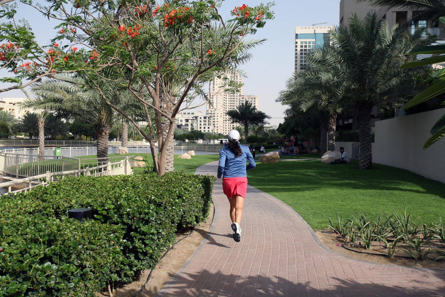 DUBAI, UNITED ARAB EMIRATES - APRIL 28:  A woman jogging in The Greens in Dubai on April 28, 2010. The Dubai Internet City Metro Station which is located close by, is one of seven new stations set to open on Friday, April 30, 2010.  (Randi Sokoloff / The National)  For A&L Oasis-Metro/and or Stock