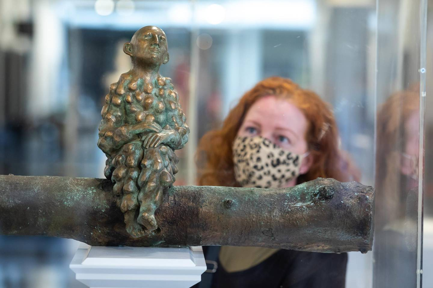 LONDON, ENGLAND - MAY 24:  A visitor looks at 'Bumpman for Trafalgar Square' by artist Paloma Varga Weisz, one of six proposals on display at the announcement of the Fourth Plinth shortlisted artworks at the National Gallery on May 24, 2021 in London, England.  The public are invited to have their say about the proposed artworks to help inform the decision of the Fourth Plinth Commissioning Group who will announce two winning sculptures in late June, 2021.  (Photo by Tim P. Whitby/Getty Images)