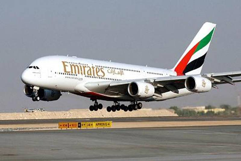 """File - In this Nov. 21, 2005 file photo, an Airbus A380 of Emirates Airlines take off for a demonstration flight during the Air show, in Dubai, United Arab Emirates. Emirates airline, the biggest buyer of the """"superjumbo"""" Airbus A380, said Wednesday, Nov. 11, 2009, it is considering increasing its order for the double-decker plane despite delays on existing orders. (AP Photo/Aziz Shah, file) *** Local Caption ***  NYBZ118_Dubai_Airbus.jpg"""