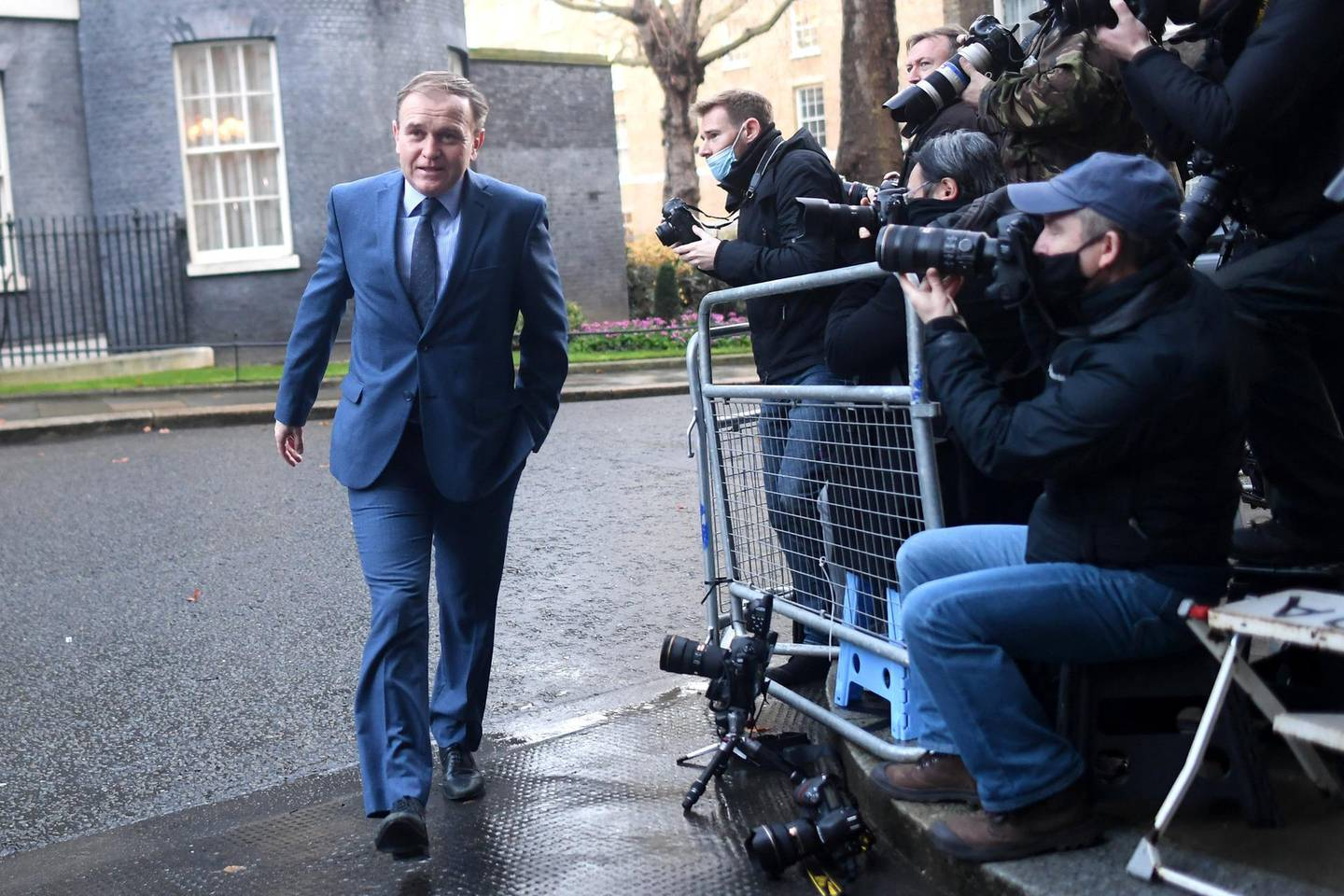 LONDON, ENGLAND - DECEMBER 15:  Environment Secretary George Eustice leaves Downing Street for a Cabinet Meeting at the FCO, on December 15, 2020 in London, England. Ministers may review the Christmas coronavirus guidelines that allow three households to meet inside for a five-day period, after a spike in cases across London and the South East that sees the area moving into Tier 3 from 00:01 Wednesday. (Photo by Peter Summers/Getty Images)