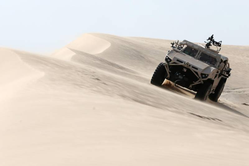 Al Ajban, United Arab Emirates, January 7, 2016:     NIMR special operations vehicle drives in the desert near their production facility in the Tawazun Industrial Park in the Al Ajban area north of Abu Dhabi on January 7, 2016. Christopher Pike / The National  Job ID: 95034 Reporter: Shereen El Gazzar Section: Business Keywords:       *** Local Caption ***  CP0107-bz-NIMR factory tour-23.JPG