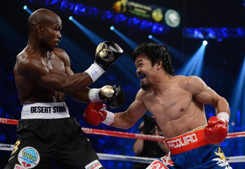 LAS VEGAS, NV - JUNE 09:  (R-L) Manny Pacquiao prepares to throw a left to the head of Timothy Bradley during their WBO welterweight title fight at MGM Grand Garden Arena on June 9, 2012 in Las Vegas, Nevada.  (Photo by Kevork Djansezian/Getty Images)