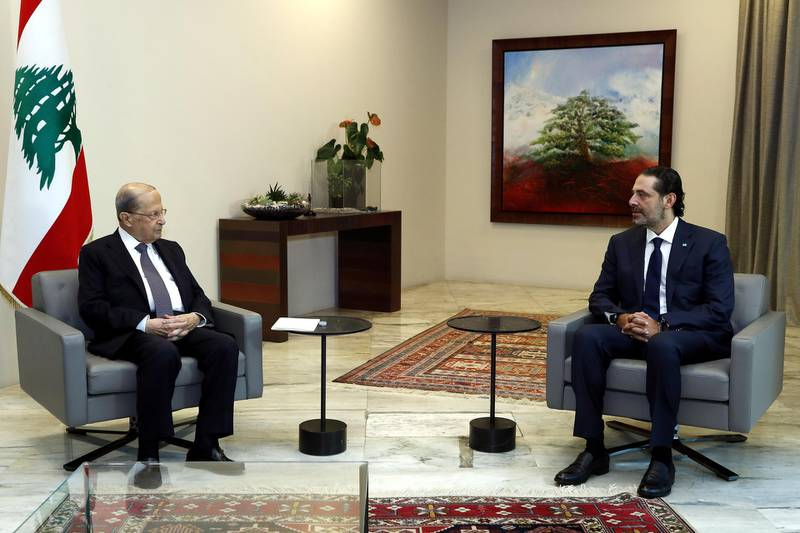 Lebanon's President Michel Aoun meets with former Prime Minister Saad al-Hariri at the presidential palace in Baabda, Lebanon October 12, 2020. Dalati Nohra/Handout via REUTERS ATTENTION EDITORS - THIS IMAGE WAS PROVIDED BY A THIRD PARTY