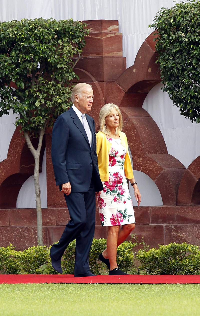 epa03797220 US Vice President Joe Biden (L) and his wife Jill Biden (R) arrive at the Gandhi Smriti, a museum dedicated to Mahatma Gandhi, in New Delhi, India, 22 July 2013. Joe Biden arrived in India for a four-day visit to boost the ties in trade, energy, defense and security.  EPA/HARISH TYAGI