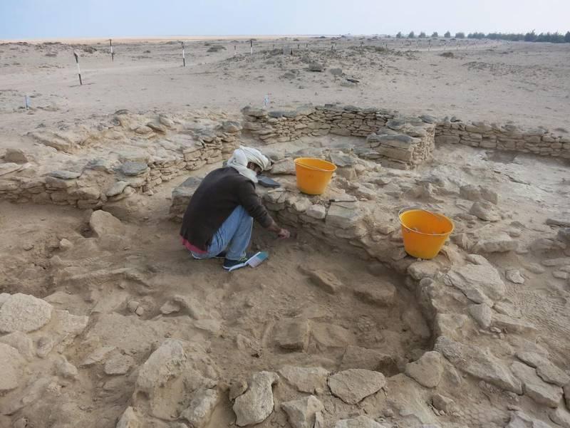 Abdulla Al Kaabi (Coastal heritage archaeologist at TCA Abu Dhabi) excavates inside Room 2 at site MR11, Marawah Island. Image Courtesy Abu Dhabi TCA *** Local Caption ***  Abdulla-Al-Kaabi-excavates-Room2-MR11.JPG