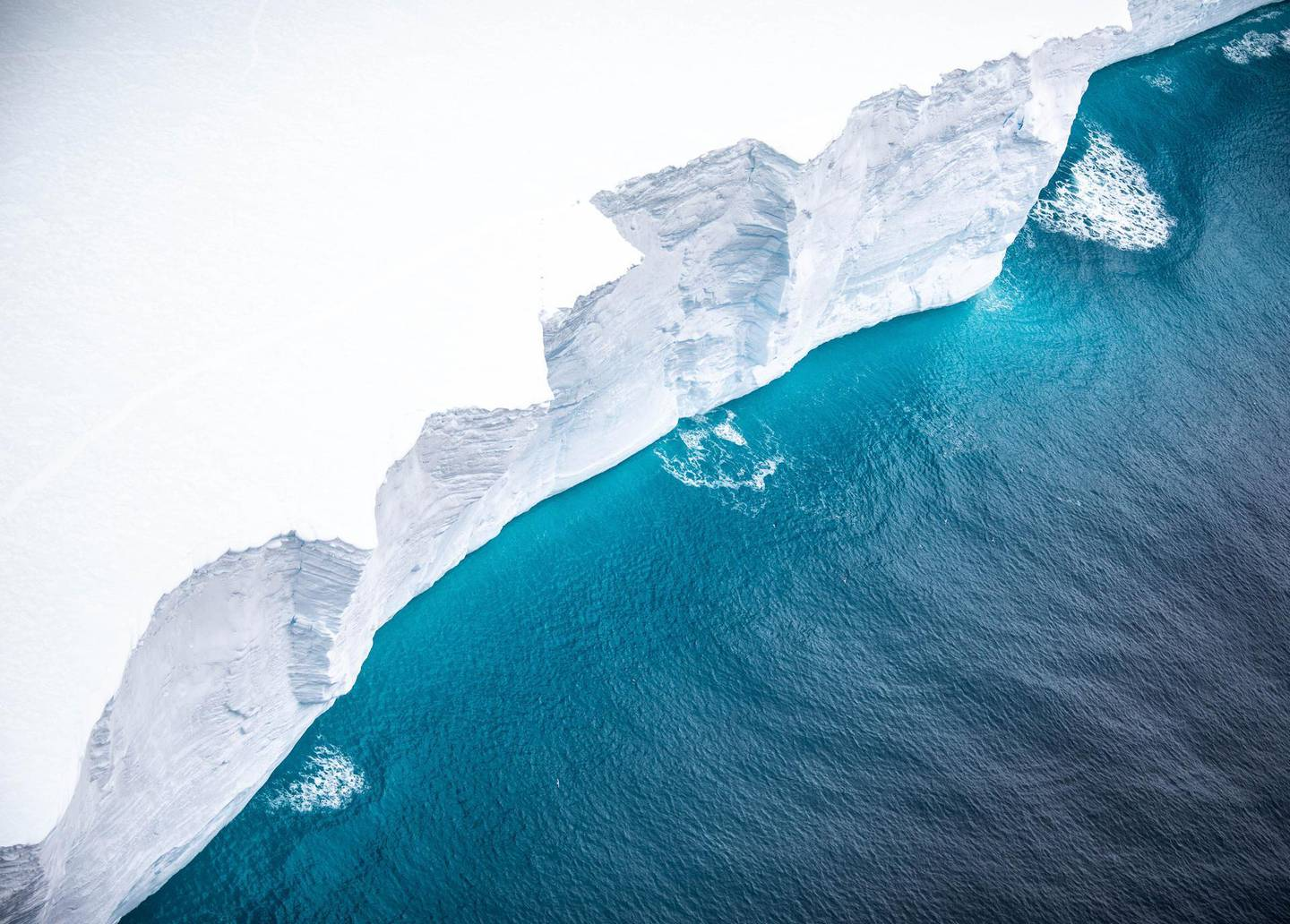 """A handout photograph released by the UK Ministry of Defence (MOD) on December 5, 2020 shows one of the largest recorded icebergs, the 4,200-sq-km block known as A68a, floating near the island of South Georgia, South Atlantic and revealing the steep vertical sides, approximately 30m high.   The image, taken from an A400M Atlas, Royal Air Force aircraft shows the first photographic evidence of this gigantic mass of ice that has transited from Antartica.  - RESTRICTED TO EDITORIAL USE - MANDATORY CREDIT  """" AFP PHOTO / UK MOD / CROWN COPYRIGHT 2019/ CORPORAL PHIL DYE""""  -  NO MARKETING NO ADVERTISING CAMPAIGNS   -   DISTRIBUTED AS A SERVICE TO CLIENTS  -  NO ARCHIVE - TO BE USED WITHIN 2 DAYS FROM DECEMBER 5 (48 HOURS), EXCEPT FOR MAGAZINES WHICH CAN PRINT THE PICTURE WHEN FIRST REPORTING ON THE EVENT  / AFP / MOD / Handout / RESTRICTED TO EDITORIAL USE - MANDATORY CREDIT  """" AFP PHOTO / UK MOD / CROWN COPYRIGHT 2019/ CORPORAL PHIL DYE""""  -  NO MARKETING NO ADVERTISING CAMPAIGNS   -   DISTRIBUTED AS A SERVICE TO CLIENTS  -  NO ARCHIVE - TO BE USED WITHIN 2 DAYS FROM DECEMBER 5 (48 HOURS), EXCEPT FOR MAGAZINES WHICH CAN PRINT THE PICTURE WHEN FIRST REPORTING ON THE EVENT"""