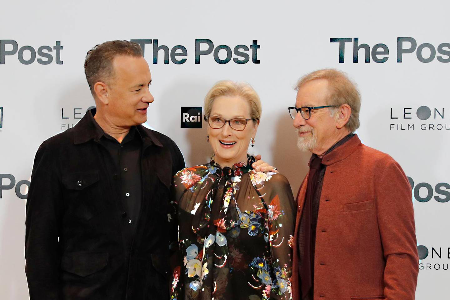 Actors Tom Hanks, from left, Meryl Streep and director Steven Spielberg pose for photographers during a photo call for the film 'The Post' in Milan, Italy, Monday, Jan.15, 2018. (AP Photo/Antonio Calanni)