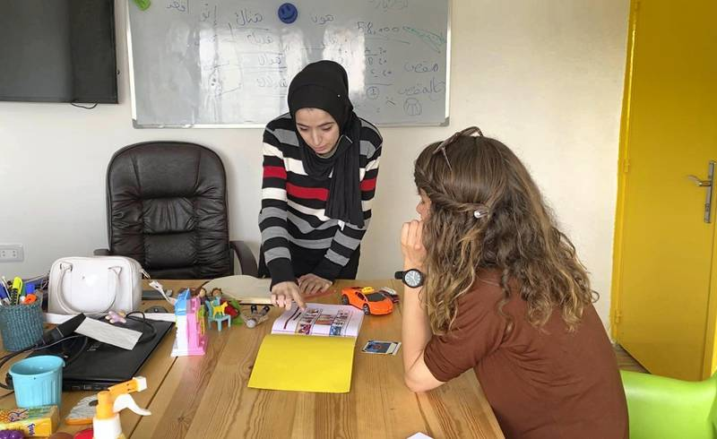 Arabic teacher Ana with a student at the Misbah Centre. Amy McConaghy / The National