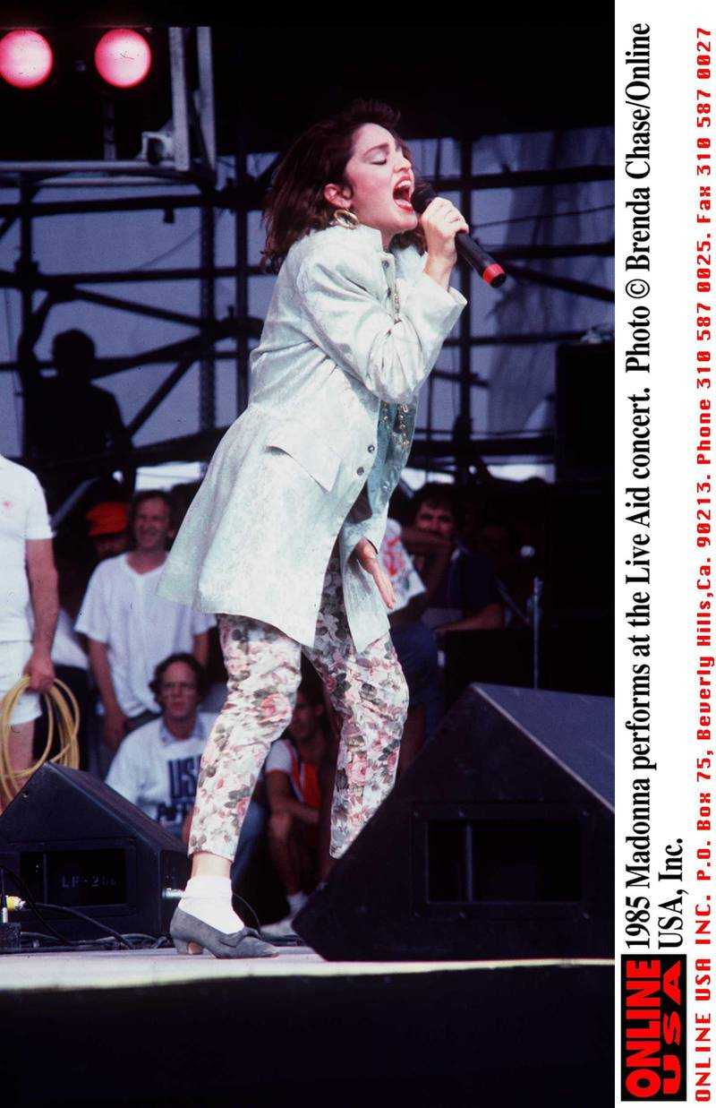 1985 Madonna performs at the Live Aid concert.