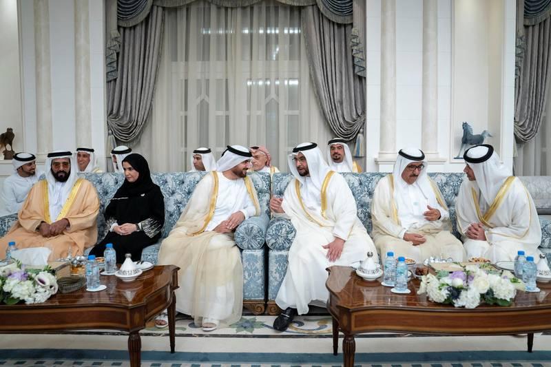 ABU DHABI, UNITED ARAB EMIRATES -June 15, 2018: (R-L) HH Sheikh Hazza bin Zayed Al Nahyan, Vice Chairman of the Abu Dhabi Executive Council, HH Sheikh Saud bin Rashid Al Mu'alla, UAE Supreme Council Member and Ruler of Umm Al Quwain, HH Sheikh Hamdan bin Zayed Al Nahyan, Ruler's Representative in Al Dhafra Region, HH Sheikh Abdullah bin Salem Al Qasimi, Deputy Ruler of Sharjah, HE Dr Amal Abdullah Al Qubaisi, Speaker of the Federal National Council (FNC) and HH Sheikh Tahnoon bin Mohamed Al Nahyan, Ruler's Representative in Al Ain Region, attend Eid Al Fitr reception at Mushrif Palace.   ( Eissa Al Hammadi for Crown Prince Court - Abu Dhabi ) ---
