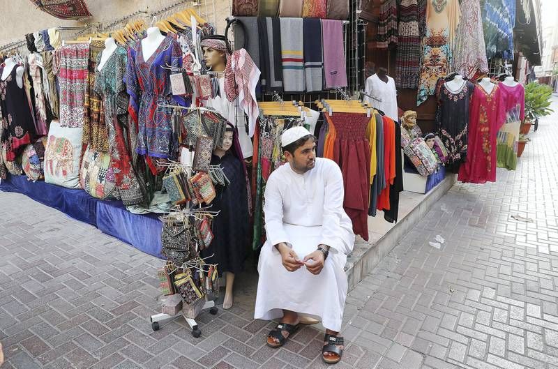 DUBAI , UNITED ARAB EMIRATES , MAY 23 – 2018 :- One of the shopkeeper sitting outside his shop during the Unseen Trails Iftar Walk presented by Gulf Photo Plus and Frying Pan Adventures in Bur Dubai area in Dubai.  ( Pawan Singh / The National )  For Weekender