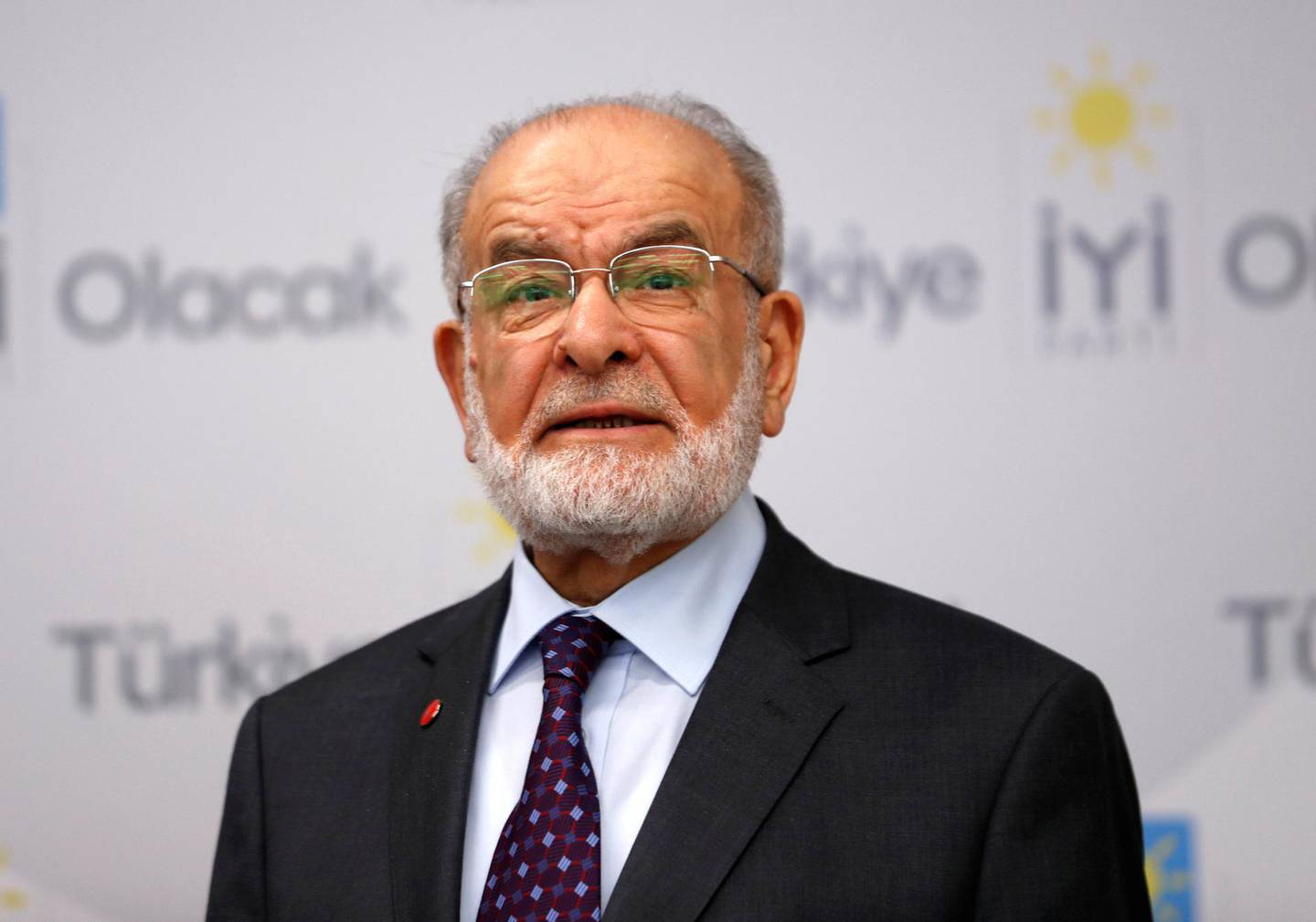 Temel Karamollaoglu, the leader of Islamist Saadet Party, is seen during a news conference with Iyi Party leader Meral Aksener (not pictured) in Ankara, Turkey April 24, 2018. Picture taken April 24, 2018. REUTERS/Murad Sezer - RC12A72C67C0