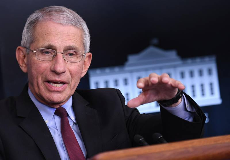 """(FILES) In this file photo Director of the National Institute of Allergy and Infectious Diseases Anthony Fauci speaks during an unscheduled briefing after a Coronavirus Task Force meeting at the White House on April 5, 2020, in Washington, DC. US President-elect Joe Biden on December 3, 2020 said he had asked the government's top infectious disease specialist Anthony Fauci to remain in his post and join his Covid-19 team after he takes office. """"I asked him to stay on in the exact same role he's had for the past several presidents,"""" Biden said in an interview with CNN, referring to the expert who outgoing President Donald Trump had suggested he would fire after the election. / AFP / Eric BARADAT"""