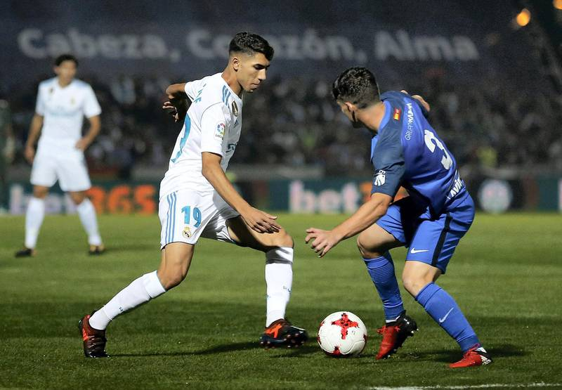 MADRID, SPAIN - OCTOBER 26:  Achraf Hakimi of Real Madrid is challenged by Fran Garcia of Fuenlabrada during the Copa del Rey round of 32 first leg match between Fuenlabrada and Real Madrid CF at Estadio Fernando Torres on October 26, 2017 in Fuenlabrada, near Madrid, Spain.  (Photo by Angel Martinez/Real Madrid via Getty Images)
