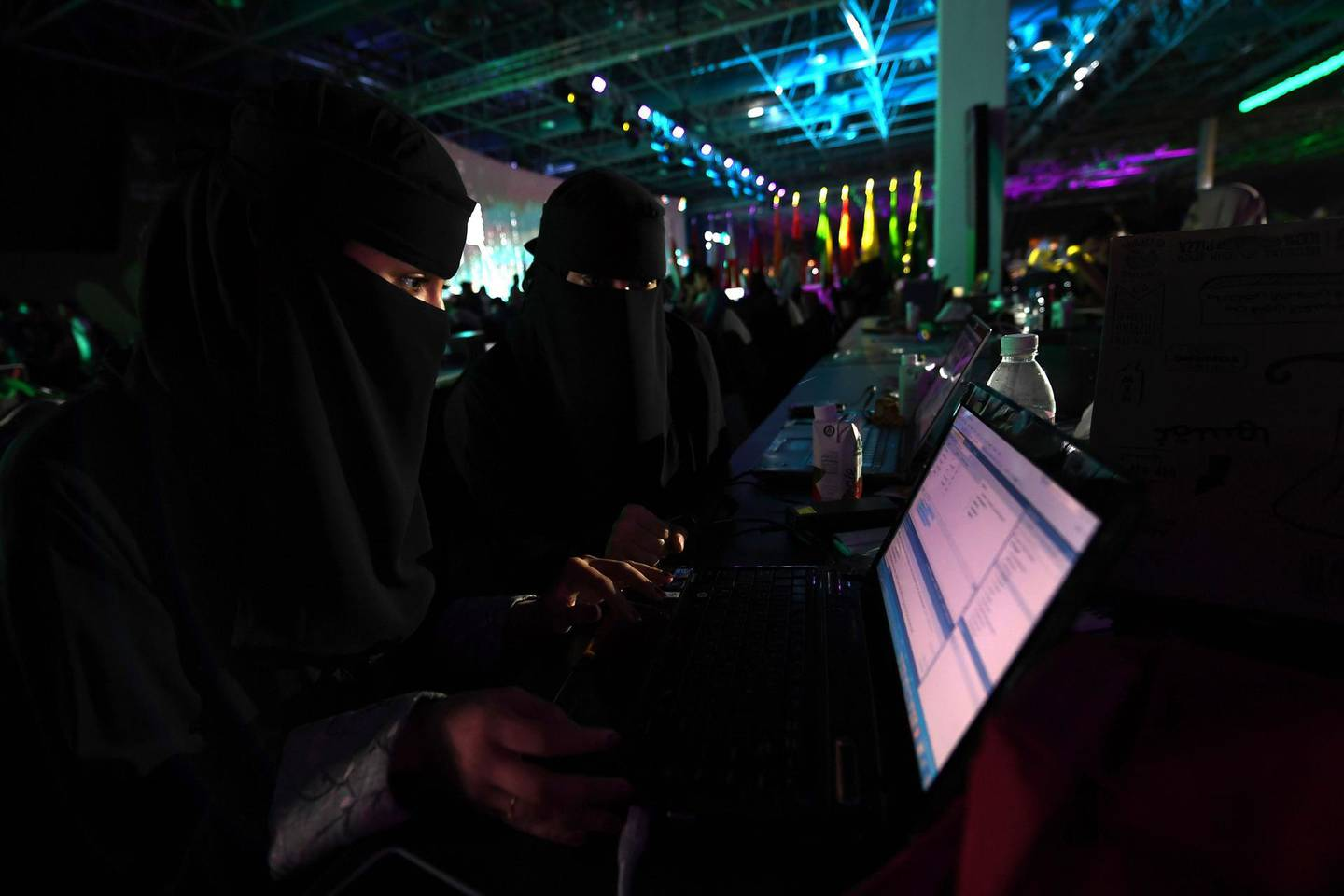 """CORRECTION - Saudi women attend a hackathon in Jeddah on July 31, 2018, prior to the start of the annual Hajj pilgrimage in the holy city of Mecca. More than 3,000 software developers and 18,000 computer and information-technology enthusiasts from more than 100 countries take part in Hajj hackathon in Jeddah until August 3. / AFP PHOTO / Amer HILABI / The erroneous byline appearing in the metadata of this photo by Amer HILABI  has been modified in AFP systems in the following manner: [Amer Hilabi] instead of [Matthieu Clavel]. Please immediately remove the erroneous mention[s] from all your online services and delete it (them) from your servers. If you have been authorized by AFP to distribute it (them) to third parties, please ensure that the same actions are carried out by them. Failure to promptly comply with these instructions will entail liability on your part for any continued or post notification usage. Therefore we thank you very much for all your attention and prompt action. We are sorry for the inconvenience this notification may cause and remain at your disposal for any further information you may require."""""""