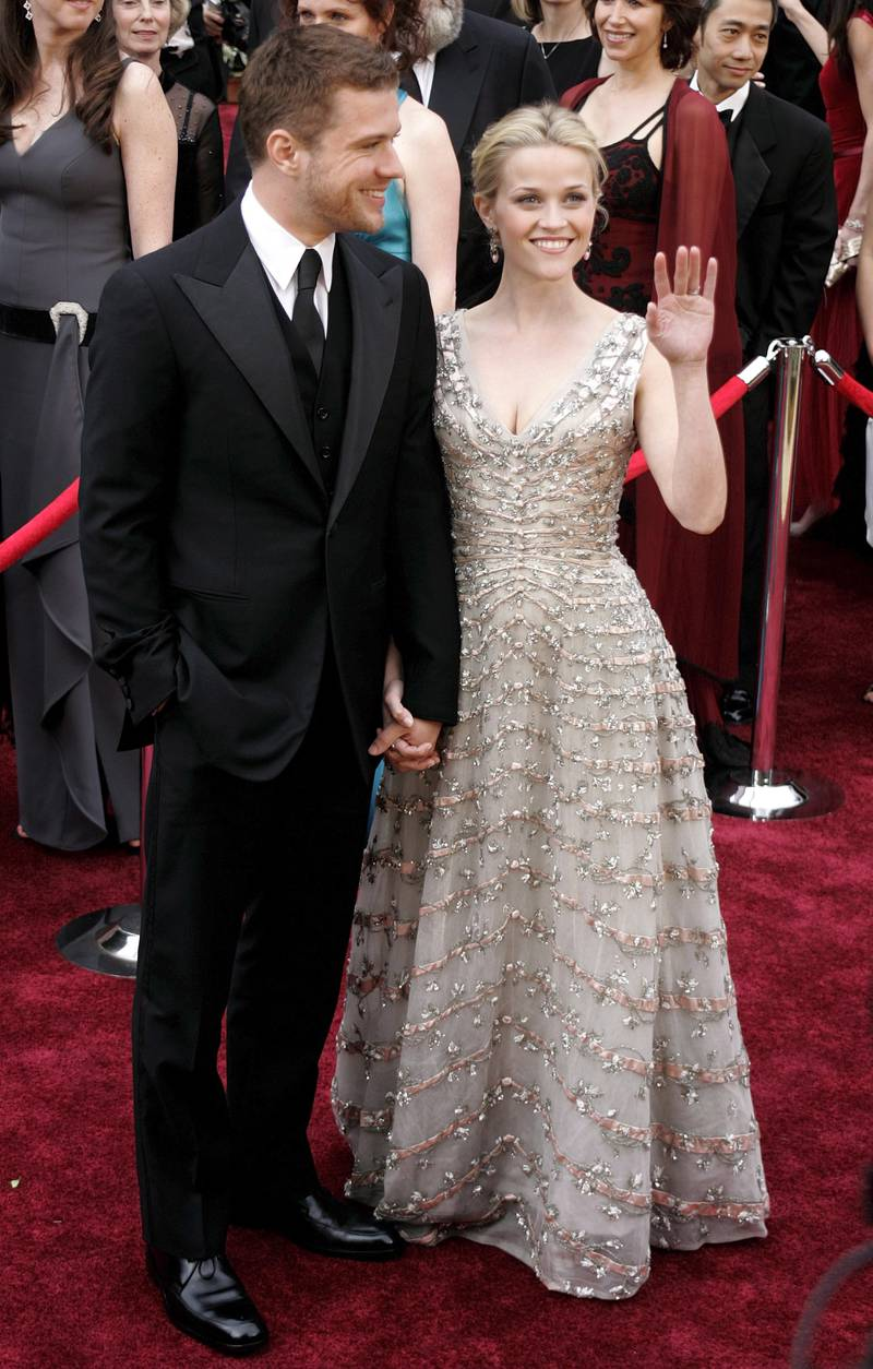 epa00660689 Actress Reese Witherspoon (R), with her husband Ryan Philipp on the red carpet during the 78th annual Academy Awards in Hollywood,  California, Sunday 05 March 2006.  EPA/ARMANDO ARORIZO