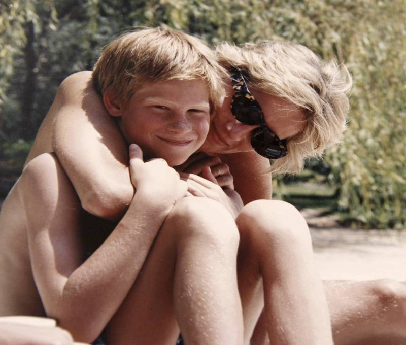"""In this photo made available by Kensington Palace from the personal photo album of the late Diana, Princess of Wales, shows the princess and Prince Harry on holiday, and features in the new ITV documentary 'Diana, Our Mother: Her Life and Legacy.' Prince William and Prince Harry will pay tribute to their mother, Princess Diana, as the 20th anniversary of her death in a car crash approaches in a TV documentary """"Diana, Our Mother: Her Life and Legacy"""" which will air Monday July 24, 2017 on British TV. (The Duke of Cambridge and Prince Harry/Kensington Palace via AP)  NO USE ON THE FRONT COVERS OF ANY UK OR INTERNATIONAL MAGAZINES. NO COMMERCIAL USE (including any use in merchandising, advertising or any other non-editorial use including, for example, calendars, books and supplements)."""