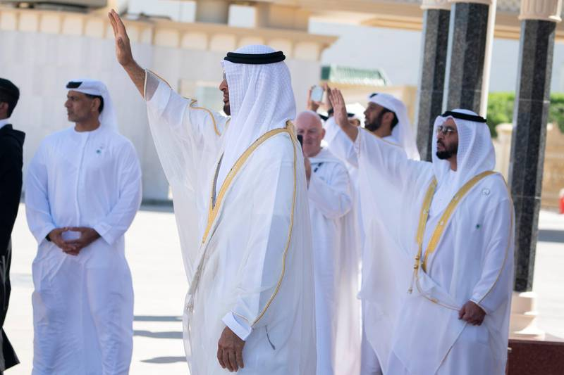 ABU DHABI, UNITED ARAB EMIRATES - February 05, 2019: Day three of the UAE Papal visit - HH Sheikh Mohamed bin Zayed Al Nahyan, Crown Prince of Abu Dhabi and Deputy Supreme Commander of the UAE Armed Forces (R), bids farewell to His Holiness Pope Francis, Head of the Catholic Church (not shown), at the Presidential Airport. Seen with HH Sheikh Hamdan bin Zayed Al Nahyan, Ruler's Representative in Al Dhafra Region (R).    ( Mohamed Al Hammadi / Ministry of Presidential Affairs ) ---