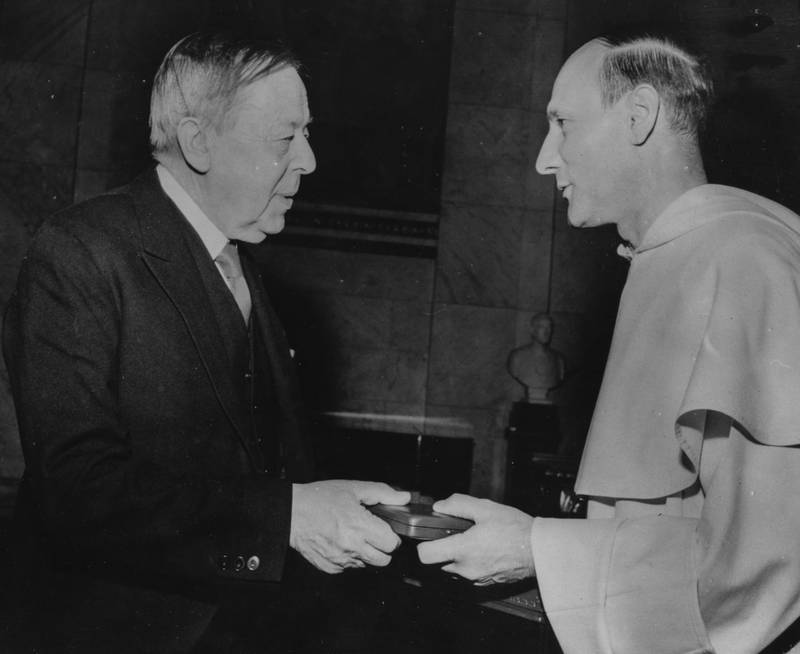 Belgian Dominican friar Dominique Pire (right), winner of the Nobel Peace Prize, receiving his award from Gunnar Jahn, President of the Norweigan Nobel Prize Committee, at a ceremony at Oslo University, December 11th 1958. (Photo by Keystone/Hulton Archive/Getty Images)
