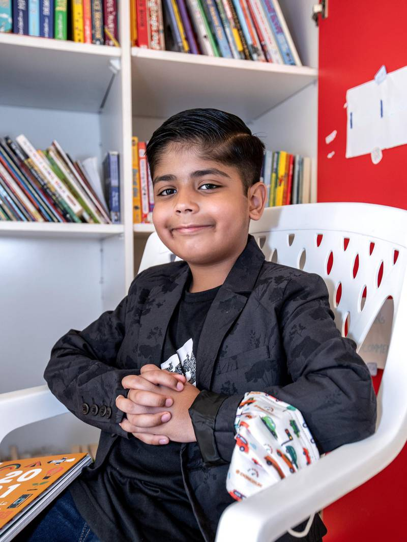 Ayaan Tariq, a 7-year-old in Al Ain has started a free library. He has a collection of around 300-400 books which he keeps in a cupboard. He lends these out to children free of charge. June 22, 2021. Victor Besa / The National.Reporter: Anam Rizi for News