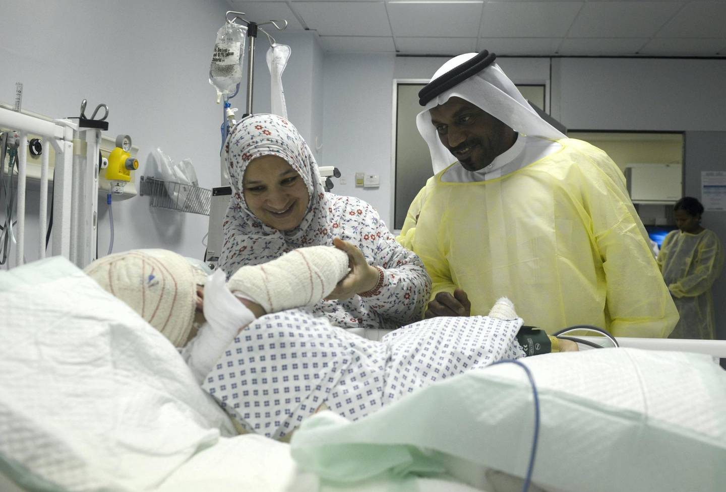 Abu Dhabi, United Arab Emirates - From left, Um Saeed, mother and Obeid Saeed, the grandfather takes care of Sheikha Saeed, two year old, badly burned after a pressure cooker explosion in the kitchen, and is admitted at Mafraq Hospital on May 31, 2018. (Khushnum Bhandari/ The National)