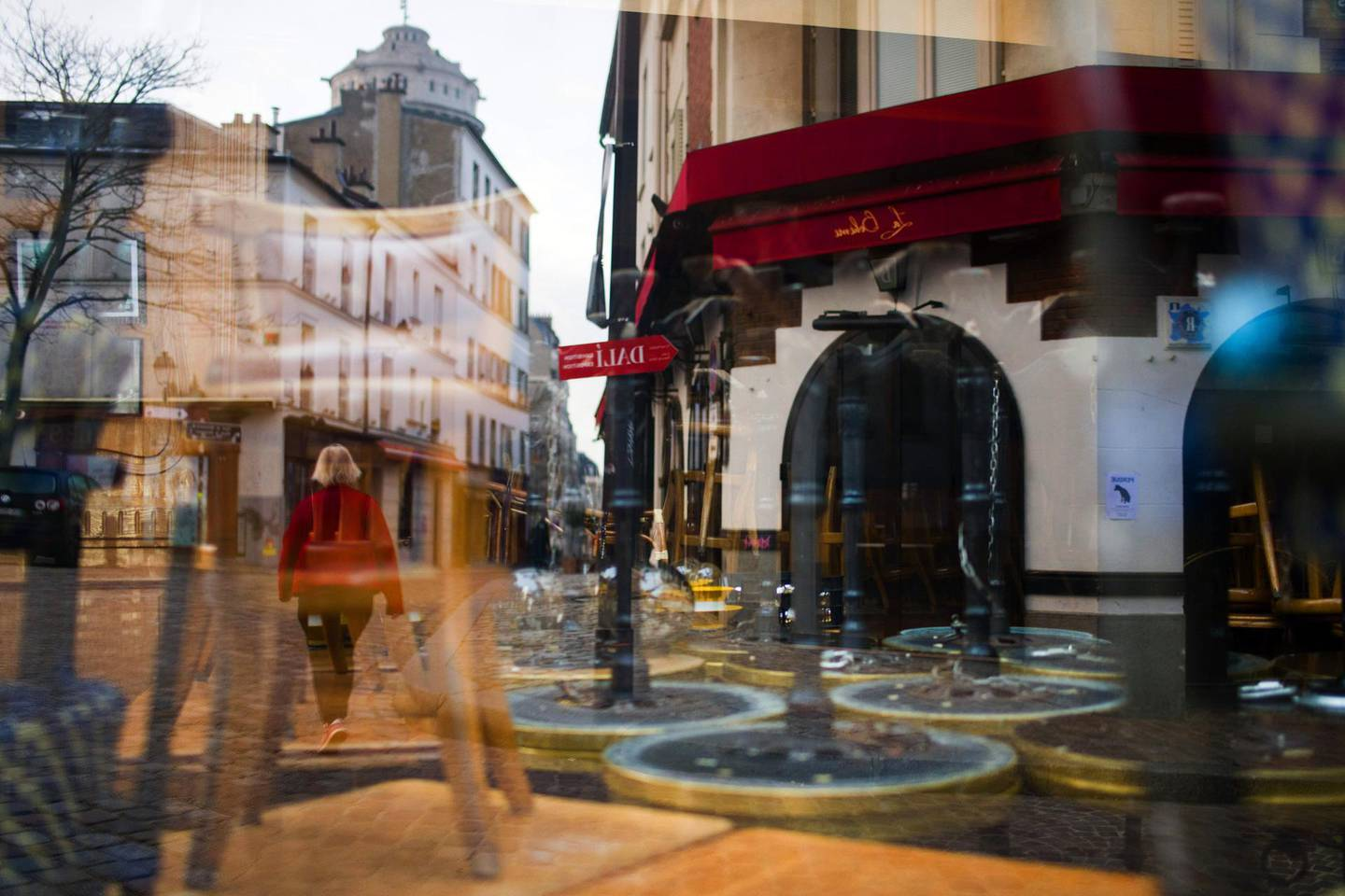 Stacked chairs inside a closed cafe in the Montmartre district in Paris, France, on Tuesday, Nov. 24, 2020. The French government plans to ease measures put in place against the deadly coronavirus in three steps as infections recede, while keeping some restrictions in place to contain the epidemic. Photographer: Nathan Laine/Bloomberg