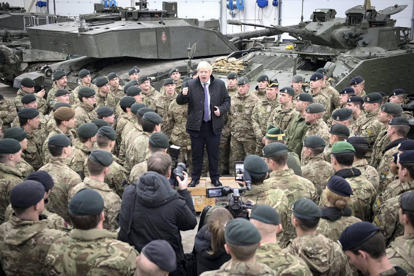 TALLINN, ESTONIA - DECEMBER 21:  Prime Minister Boris Johnson speaks to British troops stationed in Estonia during a one-day visit to the Baltic country on December 21, 2019 in Tallinn, Estonia. The base is home to 850 British troops from the Queen's Royal Hussars who lead the Nato battlegroup along with personnel from Estonia, France and Denmark. (Photo by Stefan Rousseau - Pool/Getty Images)